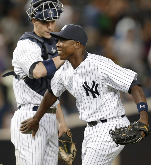 New York Yankees catcher Chris Stewart (19) congratulates left fielder Alfonso Soriano after the Yankees' 11-3 victory over the Los Angeles Angels in a baseball game, Wednesday, Aug. 14, 2013, in New York. Soriano had seven RBIs in the game. (AP Photo/Kathy Willens)
