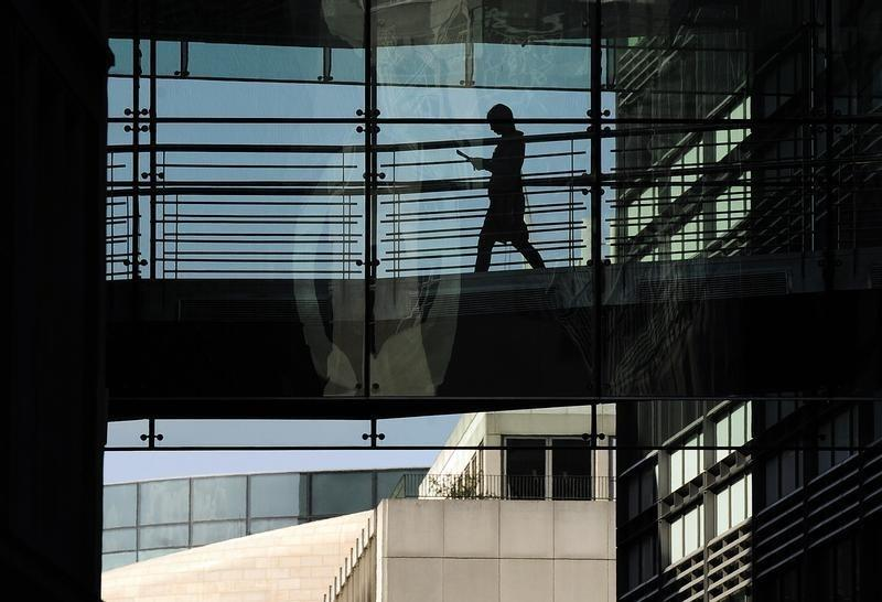 A worker passes through a walkway in an office of Goldman Sachs in London