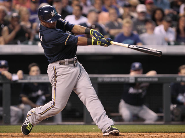 Milwaukee Brewers' Jean Segura bats against the Colorado Rockies in the fifth inning of a baseball game in Denver, Friday, June 20, 2014. (AP Photo/Joe Mahoney)