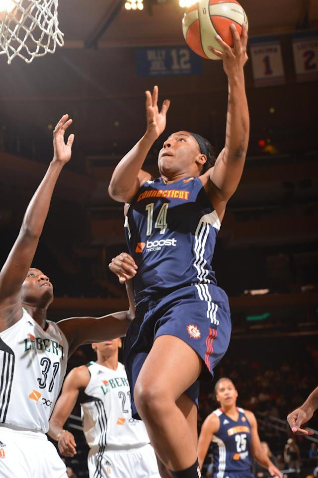 NEW YORK, NY - AUGUST 8: Kelsey Bone #14 of the Connecticut Sun shoots against the New York Liberty during the game on August 8, 2014 at Madison Square Garden in New York, New York. (Photo by Jesse D. Garrabrant/NBAE via Getty Images)