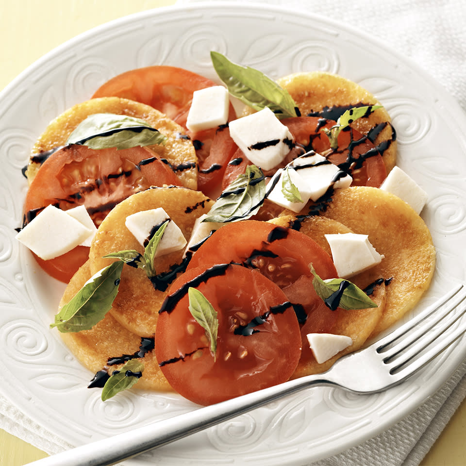 <p>The addition of polenta slices adds staying power to this classic flavorful salad.</p>