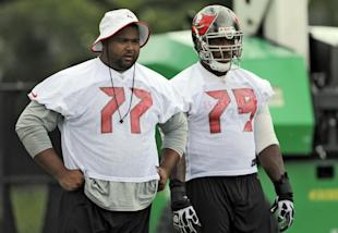 Carl Nicks (77) observes an offseason drills before leaving the team this summer. (AP)