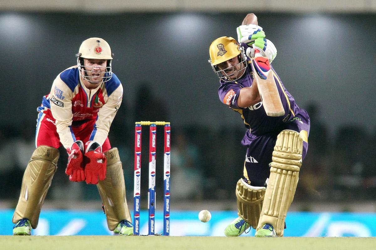 Manoj Tiwary of Kolkata Knight Riders drives a delivery during match 60 of the Pepsi Indian Premier League between The Kolkata Knight Riders and the Royal Challengers Bangalore held at the JSCA International Stadium Complex, Ranchi, India on the 12th May 2013. (BCCI)