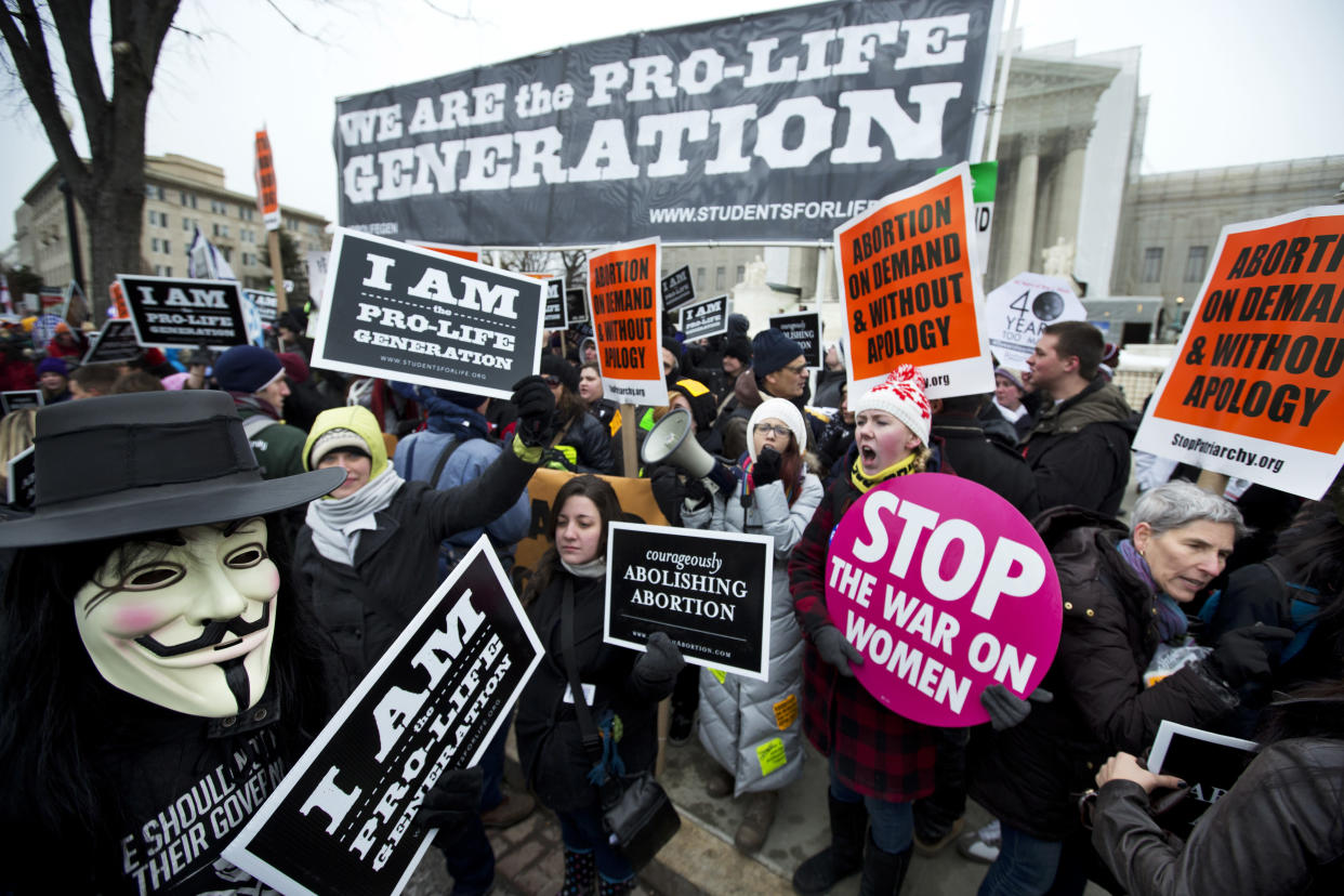 """<span class=""""s1"""">Abortion rights activists face anti-abortion demonstrators in January 2013, the 40th anniversary of Roe v. Wade. (Photo: Manuel Balce Ceneta/AP)</span>"""