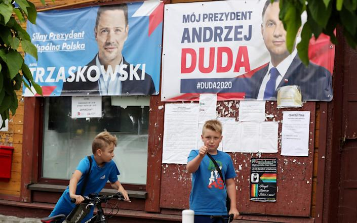 Photo election campaign posters of incumbent conservative president, Andrzej Duda, right, and his challenger, the liberal Warsaw mayor Rafal Trzaskowski - AP