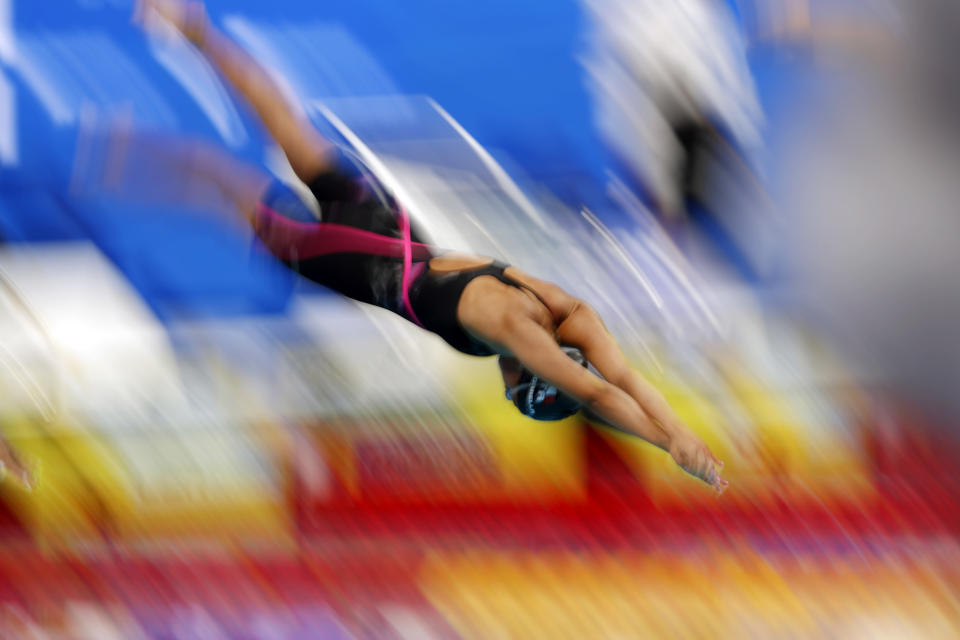 FILE - In this Tuesday, May 18, 2021 file photo, Italy's Simona Quadarella dives into the pool at the start of women's 800 meter freestyle final at the European Aquatics Championships in Duna Arena in Budapest, Hungary. Simona Quadarella is one of the few swimmers capable of challenging American standout Katie Ledecky in the longest pool races at the Tokyo Olympics. The Italian swam to gold in the 1,500-meter freestyle when Ledecky withdrew from the final due to illness at the 2019 world championships. (AP Photo/Petr David Josek, File)