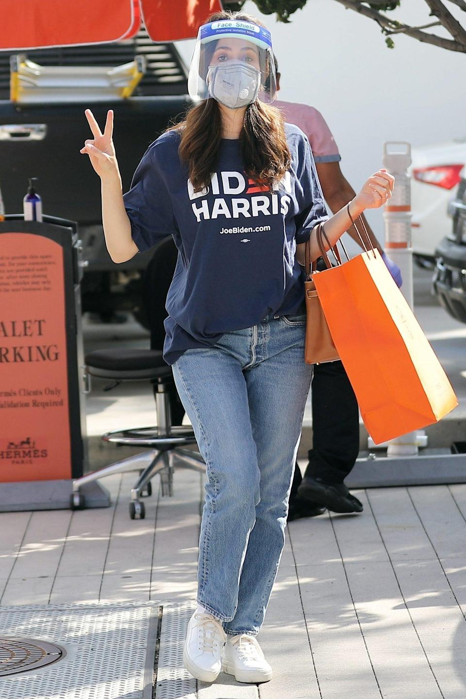 <p>Emmy Rossum dons a face shield, a mask and a tee in support of her candidate while out shopping in Beverly Hills Monday.</p>