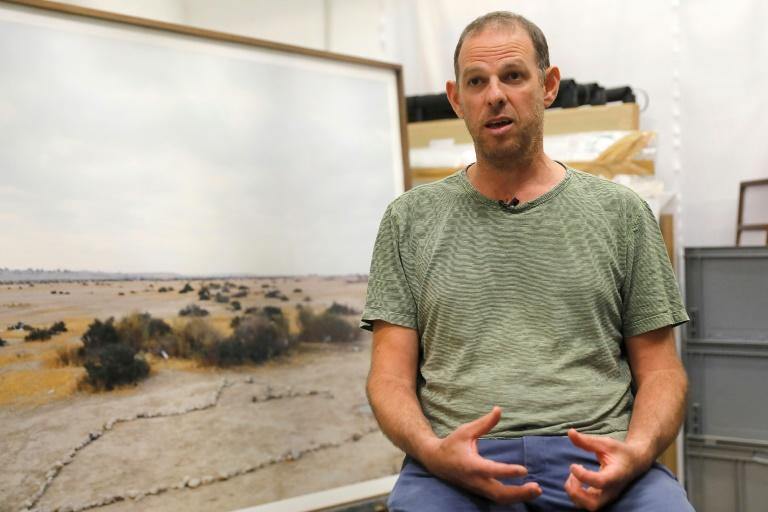 Israeli art photographer Ron Amir visited African migrants in the desert, but his pictures have no people in them, he says, to stimulate questions about what the viewer sees