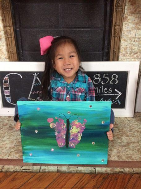 PHOTO: Four-year-old Minh Best holds up a painting of a butterfly that she created. (Courtesy Sarah Best)