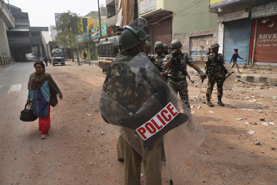Indian paramilitary soldiers stand guard after Tuesday's violence in New Delhi, India, Wednesday, Feb. 26, 2020. At least 20 people were killed in three days of clashes in New Delhi, with the death toll expected to rise as hospitals were overflowed with dozens of injured people, authorities said Wednesday. The clashes between Hindu mobs and Muslims protesting a contentious new citizenship law that fast-tracks naturalization for foreign-born religious minorities of all major faiths in South Asia except Islam escalated Tuesday. (AP Photo/Manish Swarup)