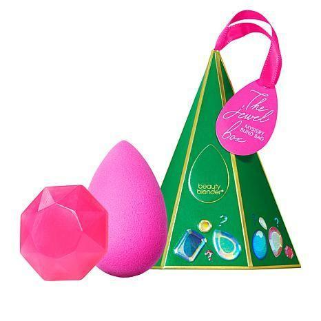 """<p><strong>beautyblender</strong></p><p>hsn.com</p><p><strong>$20.30</strong></p><p><a href=""""https://go.redirectingat.com?id=74968X1596630&url=https%3A%2F%2Fwww.hsn.com%2Fproducts%2Fbeautyblender-jewel-box-makeup-sponge-and-cleanser%2F9155781&sref=https%3A%2F%2Fwww.redbookmag.com%2Ffashion%2Fg34746885%2Fmakeup-gift-sets%2F"""" rel=""""nofollow noopener"""" target=""""_blank"""" data-ylk=""""slk:Shop Now"""" class=""""link rapid-noclick-resp"""">Shop Now</a></p><p>Part practical, part adorable: Inside this stocking-friendly ornament, there is a beautyblender sponge and solid cleanser. It'll be a surprise for everyone involved since the makeup sponge's color remains a mystery until it's unwrapped. </p>"""