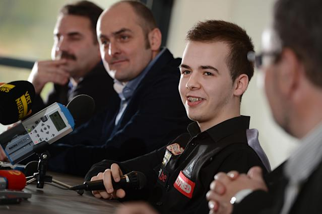 Belgian snooker player Luca Brecel (R) smiles during a press conference, in Dilsen-Stokkem, on April 18, 2012. Brecel is the youngest player ever to qualify for the Snooker World Championships, which will take place in Sheffield from April 21 to May 7 2012. AFP PHOTO / BELGA / YORICK JANSENS ***Belgium Out*** (Photo credit should read YORICK JANSENS/AFP/Getty Images)