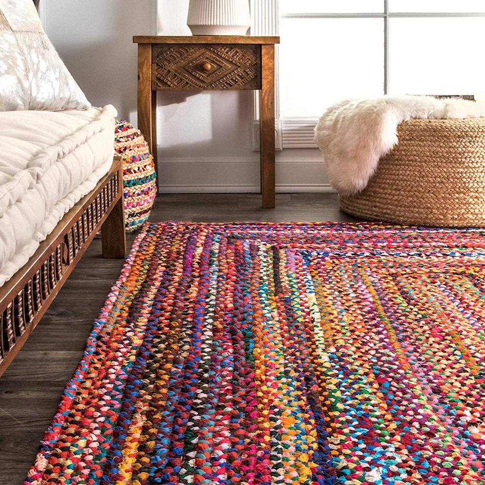 "<p>Be bold and vibrant with this multifaceted rug.</p><br><br><strong>nuLOOM </strong> Hand-Braided Cotton Square Rug (6'), $109.99, available at <a href=""https://www.amazon.com/nuLOOM-Braided-Bohemian-Colorful-Cotton/dp/B079RKK3LT"" rel=""nofollow noopener"" target=""_blank"" data-ylk=""slk:Amazon"" class=""link rapid-noclick-resp"">Amazon</a>"