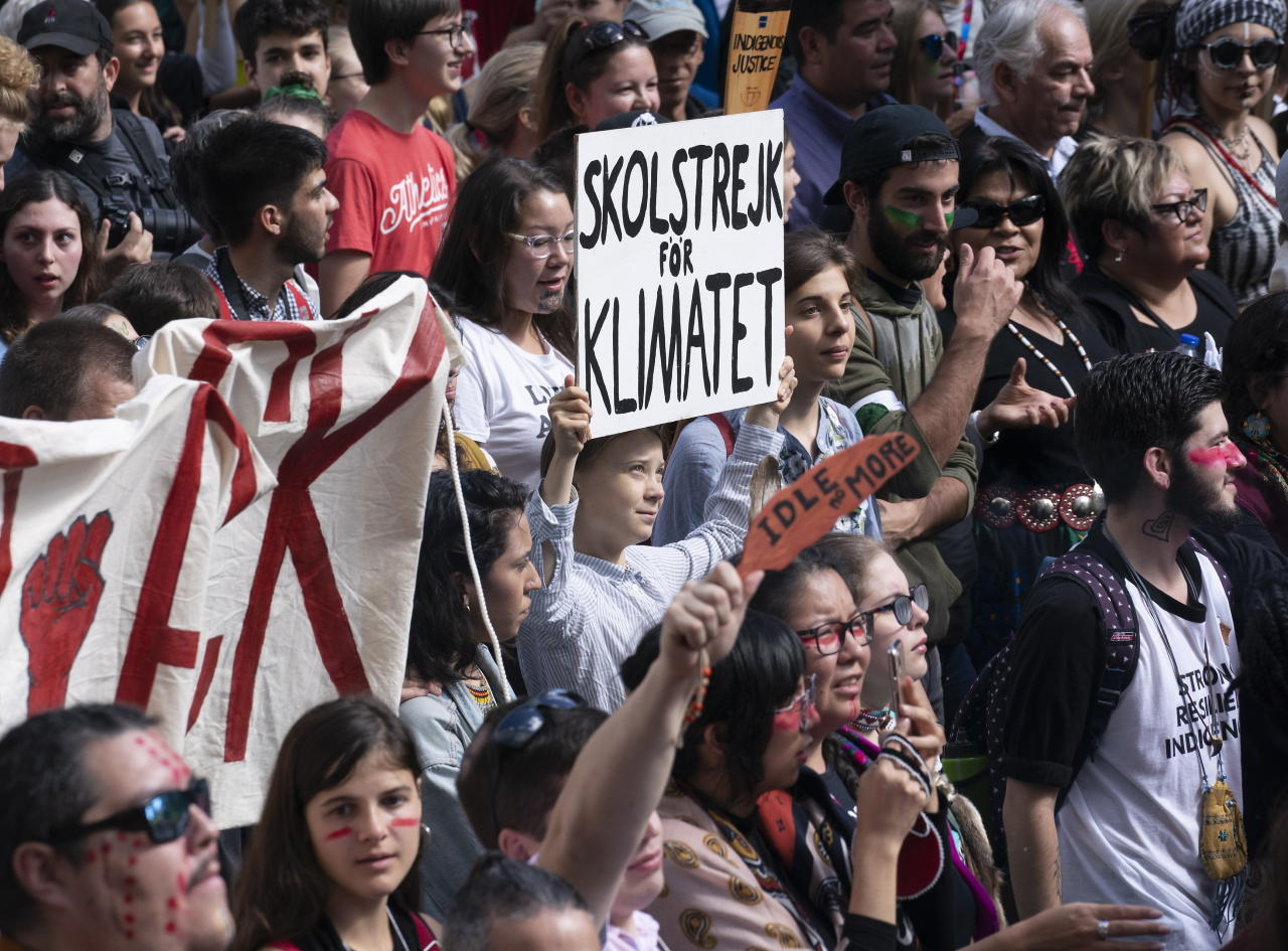 Swedish activist and student Greta Thunberg, centre, takes part in the Climate Strike, in Montreal on Friday, Sept. 27, 2019. (Paul Chiasson/The Canadian Press via AP)