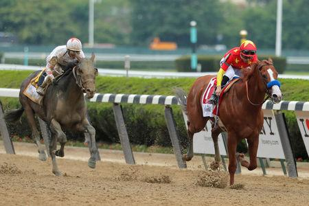 Justify clinches Triple Crown with win at Belmont Stakes