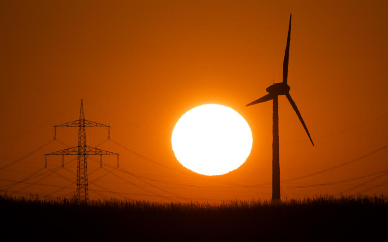 22 September 2020, Lower Saxony, Laatzen: The silhouette of a windmill (r) stands out against the rising sun. Photo: Julian Stratenschulte/dpa (Photo by Julian Stratenschulte/picture alliance via Getty Images)