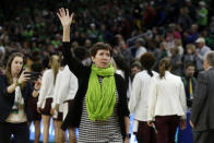 Notre Dame head coach Muffet McGraw waves to fans after a regional semifinal game against the Texas A&M in the NCAA women's college basketball tournament, Saturday, March 30, 2019, in Chicago. Notre Dame won 87-80. (AP Photo/Kiichiro Sato)