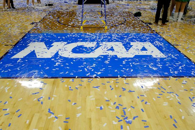 The NCAA logo covered in confetti after a D-II Final Four game. (Photo by Jeffrey Brown/Icon Sportswire via Getty Images)