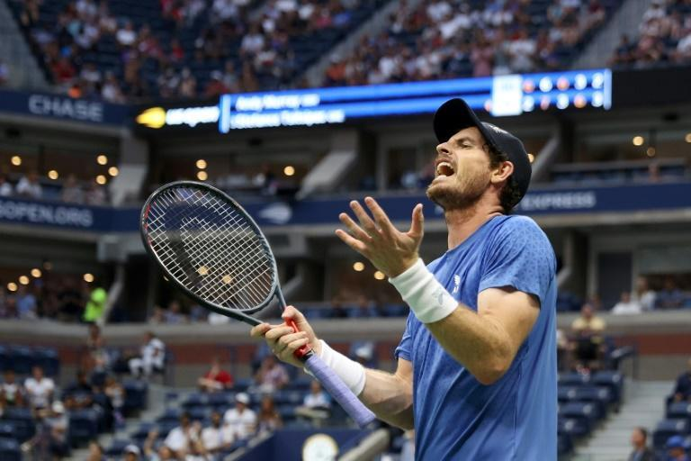 Three-time Grand Slam winner Andy Murray of Britain lost for the first time in 15 first-round matches at the US Open, falling to Greek third seed Stefanos Tsitsipas on Monday in five sets (AFP/ELSA)