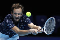 Daniil Medvedev of Russia plays a return to Dominic Thiem of Austria during their singles final tennis match at the ATP World Finals tennis tournament at the O2 arena in London, Sunday, Nov. 22, 2020. (AP Photo/Frank Augstein)