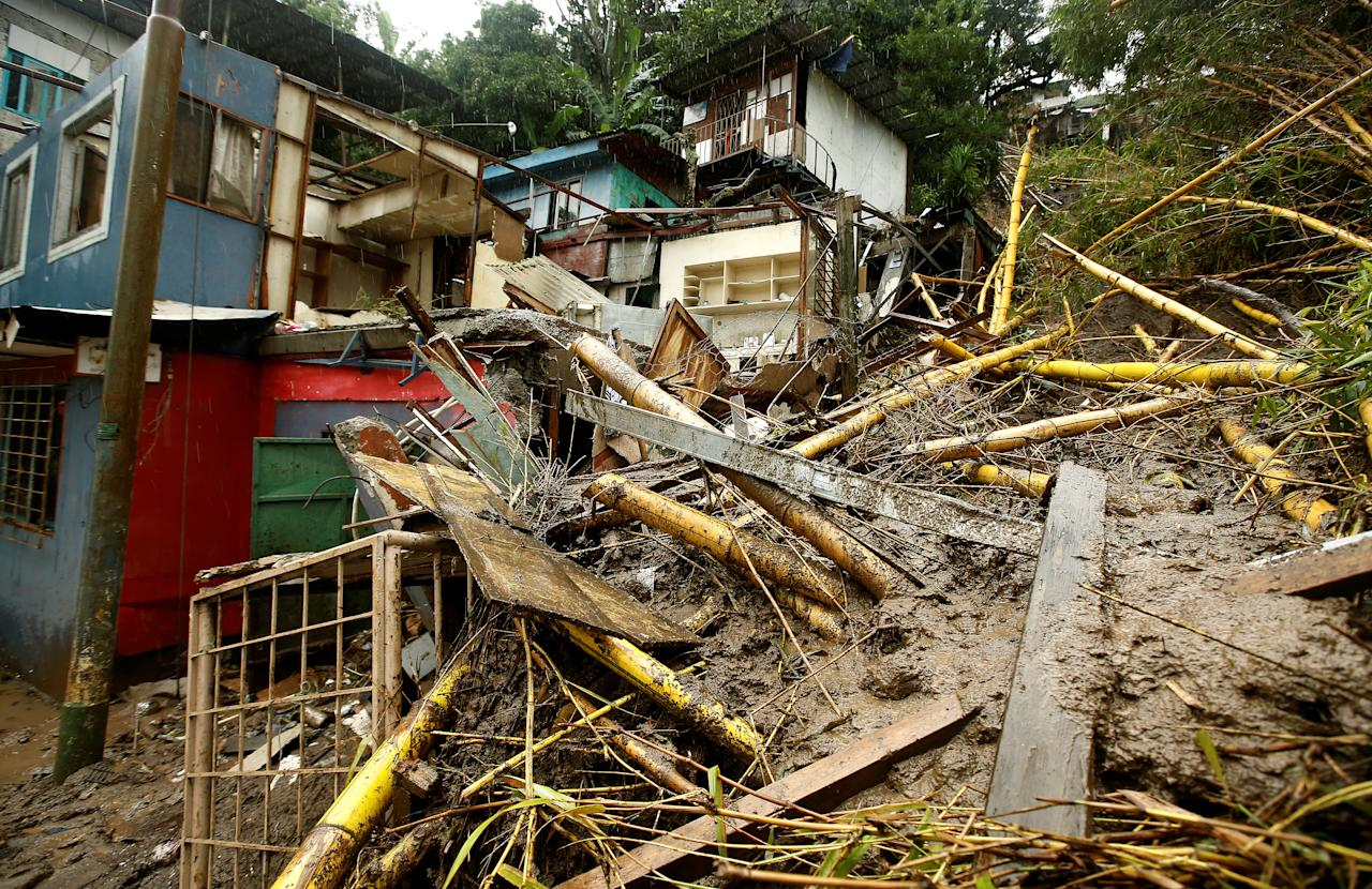 <p>Houses damaged by a mudslide are seen during heavy rains of Tropical Storm Nate that affects the country in San Jose, Costa Rica, Oct. 5, 2017. (Photo: Juan Carlos Ulate/Reuters) </p>