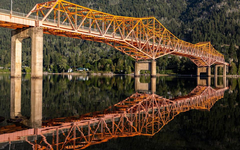 The Big Orange Bridge at Nelson is reflected in the Kootenay River