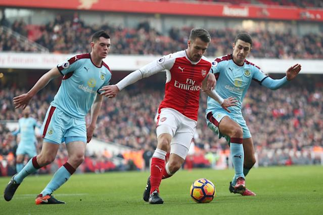 <p>Aaron Ramsey is closed down well by two Burnley players </p>