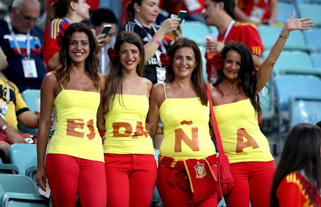 <p>Viva Espana: Coordinated Spain fans kit themselves out in the famous red and yellow. (Getty) </p>