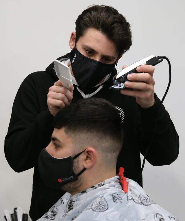 Barber with customer