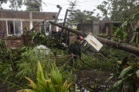 A man inspects the damage after part of his home was toppled by winds brought on by Hurricane Grace, in Tecolutla, Veracruz State, Mexico, Saturday, Aug. 21, 2021. Grace hit Mexico's Gulf shore as a major Category 3 storm before weakening on Saturday, drenching coastal and inland areas in its second landfall in the country in two days. (AP Photo/Felix Marquez)