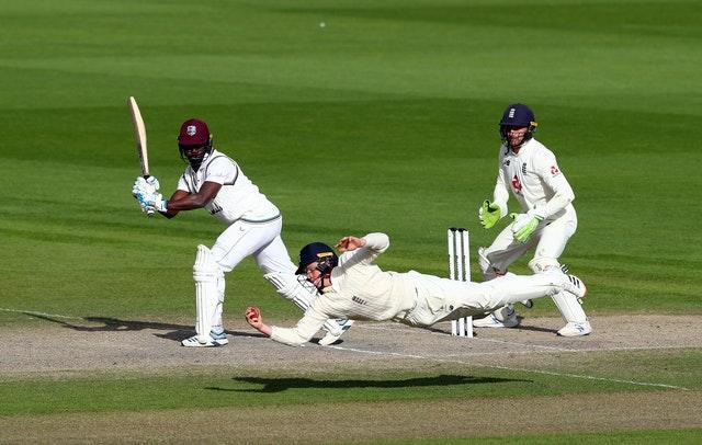 England's Ollie Pope takes the winning catch to dismiss West Indies batsman Kemar Roach during day five of the Second Test at Old Trafford. Pope's outstanding short-leg grab off the bowling of Dom Bess came after Ben Stokes' brilliance - a first-innings knock of 176 followed by 78 not out - put the hosts on course for victory. England went on to win the series 2-1