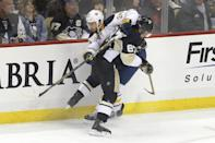 Pittsburgh Penguins' Sidney Crosby (87) hits Buffalo Sabres' Tyson Strachan (24) along the boards in the first period of an NHL hockey game, Saturday, Nov. 1, 2014 in Pittsburgh. (AP Photo/Keith Srakocic)