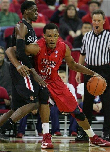 San Diego State's DeShawn Stephens battles Fresno State's Robert Upshaw in the second half of an NCAA college basketball game Wednesday, Jan. 9, 2013 in Fresno, Calif