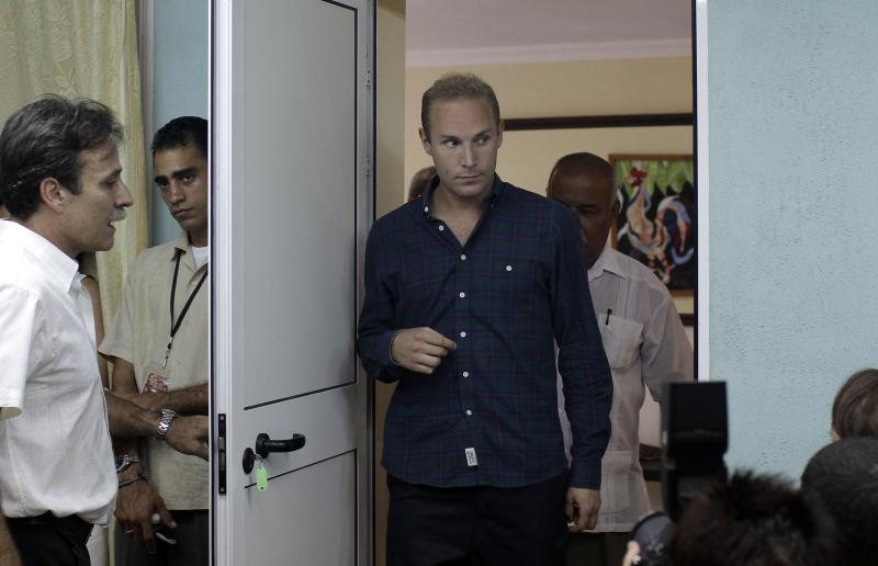 Swedish Jens Aron Modig arrives at a press conference in Havana, Cuba, Monday, July 30, 2012. Modig and Spanish citizen Angel Carromero who were traveling with Cuban dissident Oswaldo Paya when he died in a car crash are denying speculation that a second vehicle was involved. Modig backs up investigators' report that the driver braked abruptly after entering an unpaved construction zone and lost control. (AP Photo/Franklin Reyes)