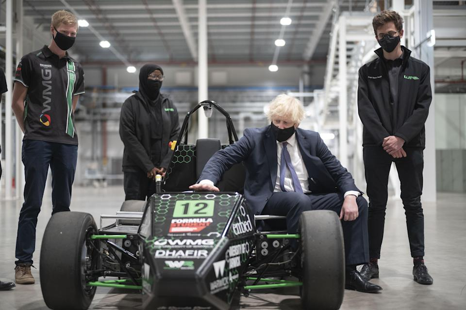 Boris Johnson with an electric car during his visit to the UK Battery Industrialisation Centre in Coventry (Daily Telegraph/David Rose/PA) (PA Wire)