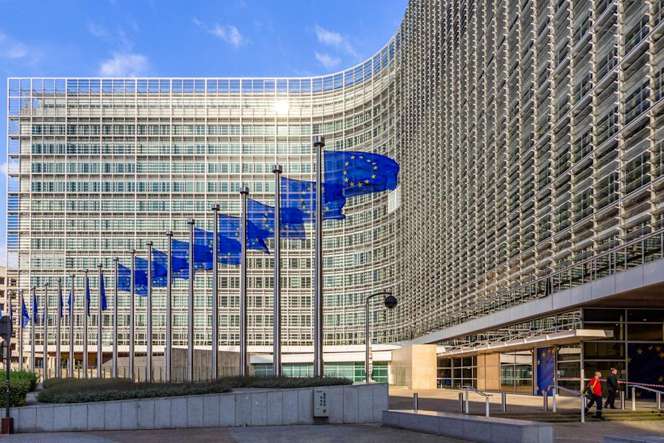 Brussels, Belgium - July 30, 2014: Row of EU Flags in front of the European Union Commission building in Brussels.
