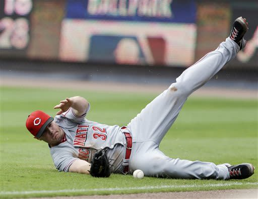 Cincinnati Reds right fielder Jay Bruce can't come up with a ball hit for an RBI double by Atlanta Braves' Gerald Laird in the second inning of a baseball game, Sunday, July 14, 2013 in Atlanta. (AP Photo/John Bazemore)