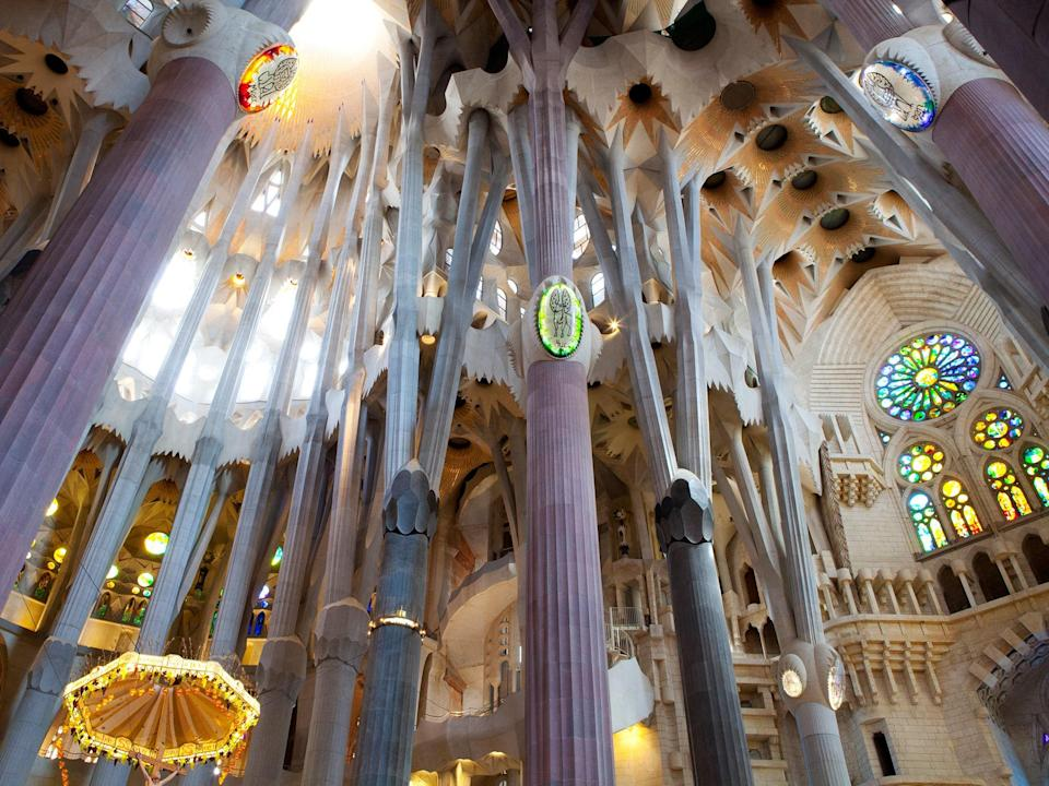 """Easily one of the most recognizable churches in the world, <a href=""""https://www.cntraveler.com/activities/barcelona/la-sagrada-familia?mbid=synd_yahoo_rss"""" rel=""""nofollow noopener"""" target=""""_blank"""" data-ylk=""""slk:La Sagrada Família"""" class=""""link rapid-noclick-resp"""">La Sagrada Família</a> is such a feat of perfection that it famously may never be finished—but that shouldn't stop you from visiting the <a href=""""https://www.cntraveler.com/destinations/barcelona?mbid=synd_yahoo_rss"""" rel=""""nofollow noopener"""" target=""""_blank"""" data-ylk=""""slk:Barcelona"""" class=""""link rapid-noclick-resp"""">Barcelona</a> landmark. You'll have to fight the 4.5 million annual visitors for the best views, but once you look up and see those towering vaults and rainbow stained glass, you can't help but gasp out loud."""