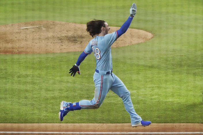 Texas Rangers designated hitter Jonah Heim celebrates as he heads to home plate after hitting the game-winning home run in the ninth inning of a baseball game against the Seattle Mariners Sunday, Aug.1, 2021, in Arlington, Texas. (AP Photo/Louis DeLuca)