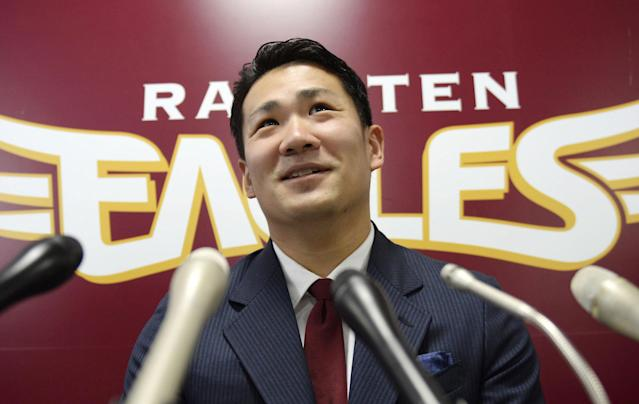 FILE - In this Dec. 17, 2013 file photo, Rakuten Golden Eagles pitcher Masahiro Tanaka speaks at a press conference after a meeting with his club president, in Sendai, northern Japan. Tanaka's team says it has decided to let him seek his career in Major League baseball next season, reversing its earlier rejection. Rakuten Eagles president Yozo Tachibana told a news conference Wednesday, Dec. 25, 2013 that it has decided to release him through the posting system. (AP Photo/Kyodo News, File)
