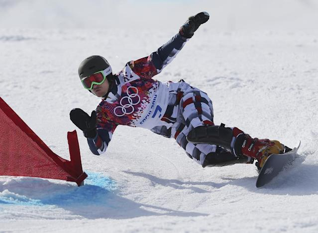 Russia's Vic Wild competes on the way to winning the men's snowboard parallel giant slalom semifinal at the Rosa Khutor Extreme Park, at the 2014 Winter Olympics, Wednesday, Feb. 19, 2014, in Krasnaya Polyana, Russia. (AP Photo/Sergei Grits)
