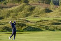 Team USA's Collin Morikawa hits on the fifth hole during a foursome match the Ryder Cup at the Whistling Straits Golf Course Friday, Sept. 24, 2021, in Sheboygan, Wis. (AP Photo/Jeff Roberson)