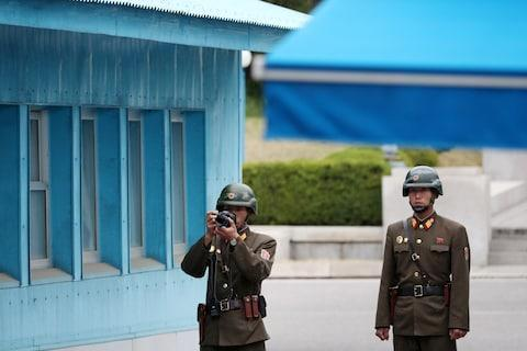 <span>Soldiers in the DMZ</span> <span>Credit: BLOOMBERG </span>