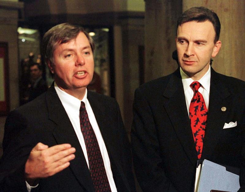 Congressmen Lindsey Graham (L) R-SC, and James Rogan (R-CA) speak to the press following the private questioning of White House aide Sidney Blumenthal in the U.S. Senate impeachment trial of President Bill Clinton on Capitol Hill, February 3, 1999. (Photo: Reuters)
