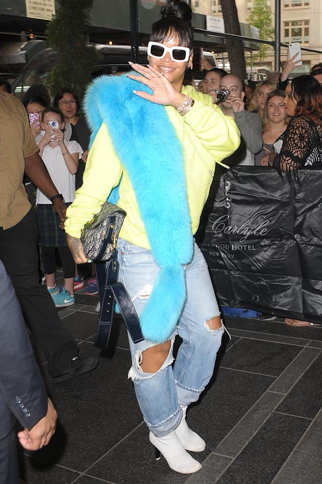 <p>Before heading to the Met Gala, Rihanna wore her Raen sunglasses with a bright yellow sweatshirt and furry stole outside the Carlye Hotel in New York City. (Photo: Backgrid USA) </p>