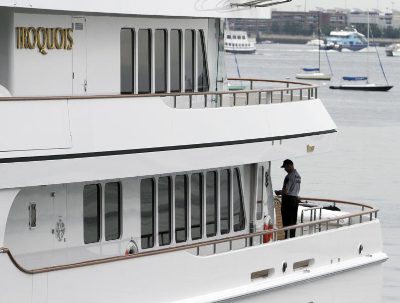 "Police work aboard Boston Red Sox owner John Henry's yacht ""Iroquois,"" moored at Rowes Wharf in Boston, Monday, June 3, 2013. Police spokeswoman Cheryl Fiandaca says that the victim is a man 28 to 30 years old. (AP Photo/Bill Sikes)"