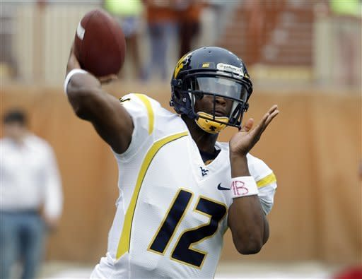 West Virginia quarterback Geno Smith throws before an NCAA college football game against Texas, Saturday, Oct. 6, 2012, in Austin, Texas. (AP Photo/Eric Gay)
