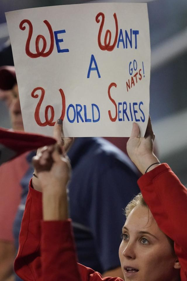 A Washington Nationals fan cheers during the fifth inning of Game 3 of the baseball National League Championship Series against the St. Louis Cardinals Monday, Oct. 14, 2019, in Washington. (AP Photo/Alex Brandon)