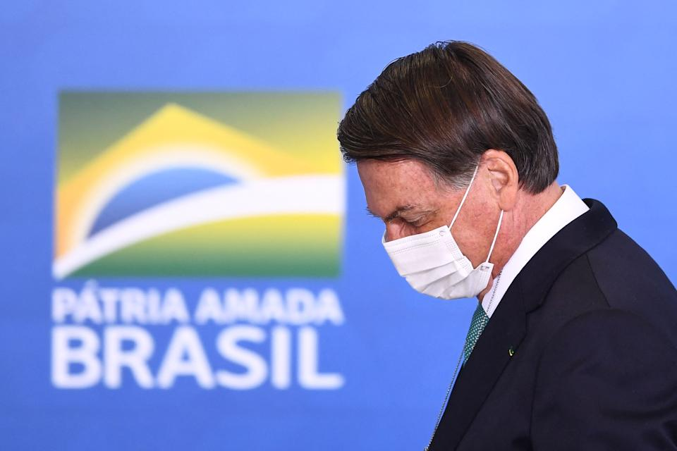 Brazilian President Jair Bolsonaro attends the announcement of sponsorship of olympic sports team by the state bank Caixa Economica Federal at Planalto Palace on June 1, 2021. - Brazil's President Jair Bolsonaro said on Tuesday that, if it depends on his government, his country will host the 2021 Copa America, in a bid to reduce uncertainty over the hosting of the world's oldest national team tournament. (Photo by EVARISTO SA / AFP) (Photo by EVARISTO SA/AFP via Getty Images)