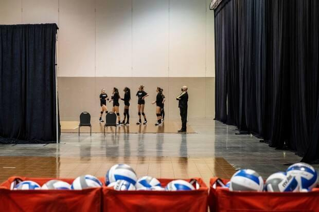 The Central Florida women's volleyball team practices before the NCAA volleyball tournament on Tuesday. The NCAA is being criticized for subpar conditions at the Omaha, Neb., bubble. (Chris Machian/Omaha World-Herald via AP - image credit)